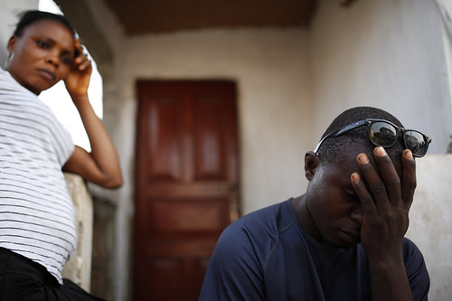 photo credit: World Bank Photo Collection The wife of ebola survivor listens to her husband via photopin (license)